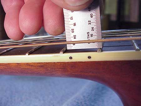 This is how luthiers check the action on a guitar.